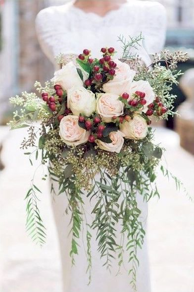 Christmas wedding ideas with urban style. Add some red berries to your wedding bouquet. Photo: Sarah Sidwell Photography, Nashville, Tennessee Photographer.