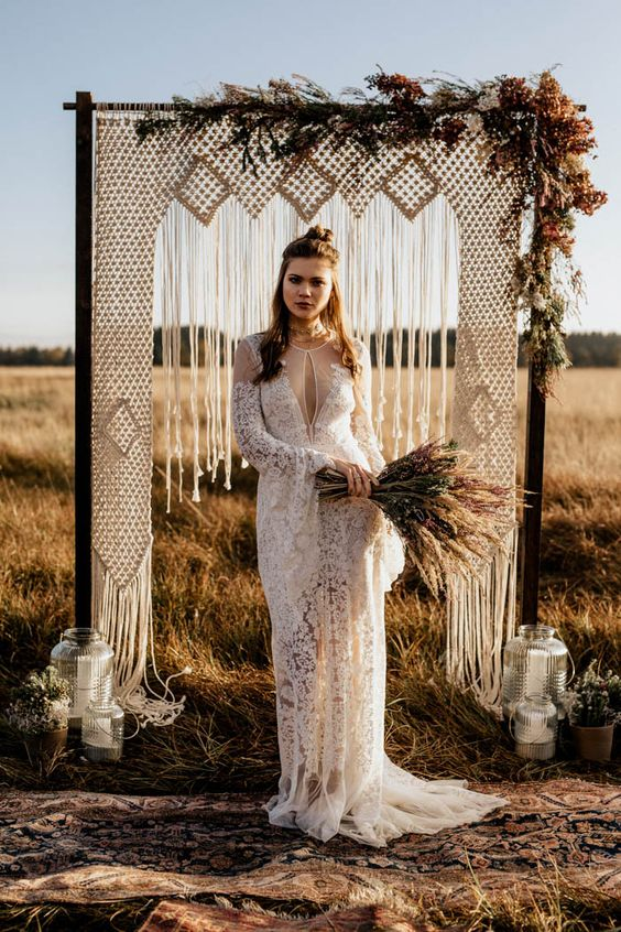 A stunning macrame arch and a fab vintage lace dress make this elopement a boho folk dream come to life. Photo: Chris and Ruth Photography.