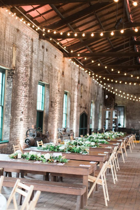 2018 wedding trends: pick the most original wedding venue you can think of, like this train museum with Industrial and minimal reception style. Photography: The Happy Bloom.