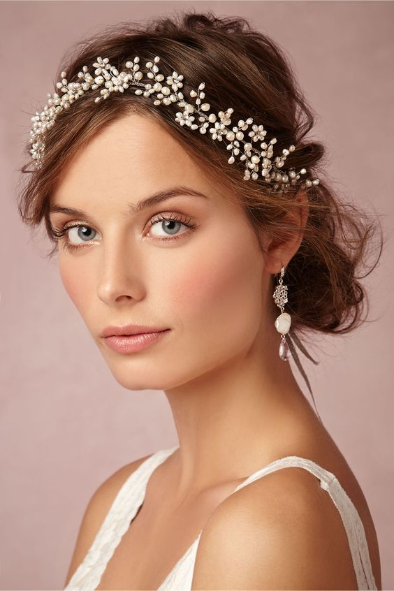 Delicate natural bridal makeup look finished off with the perfect accessories.