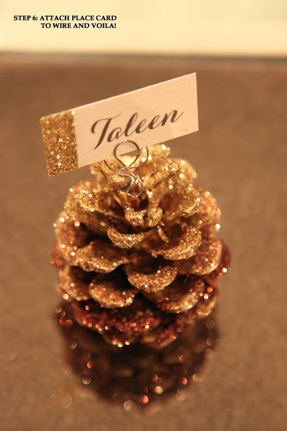 Glittery gold pinecone place card holder.