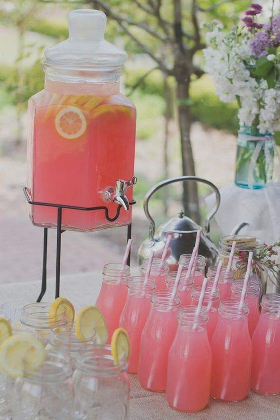 Pick a color and use it on the beverages. Pink is cute and feminine. Save on the glasses by using a bunch of mason jars. Photo: Brittany and Devin Co.