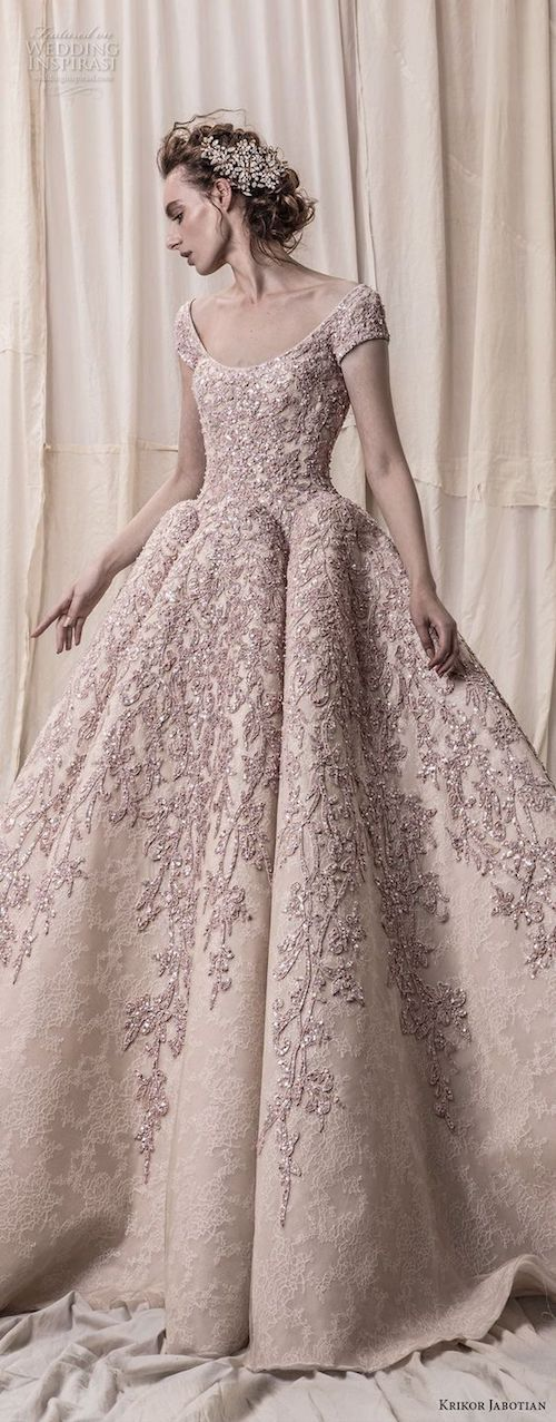 Unforgettable scoop neckline wedding gown by Krikor Jabotian. Don't add any wedding jewelry to it!