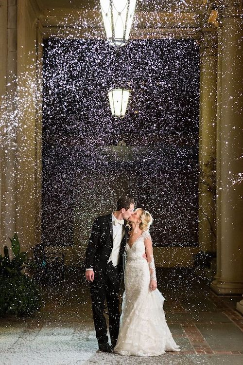 Snow machine send off for a Christmas wedding at the Biltmore in Atlanta, GA. Photography: Rick + Anna.