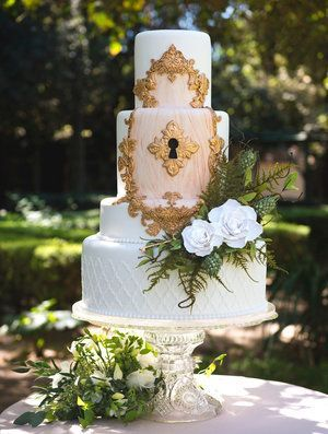 Go minimalistic or go super grand with a vintage enchanted forest wedding and a cake right out of a fairytale. By Gigi Mallatt Events.
