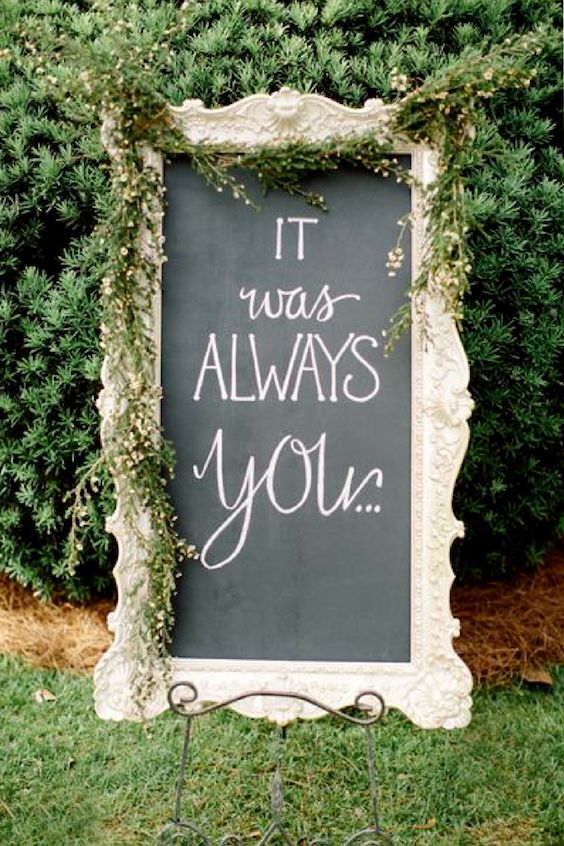 Switch the simple rustic wedding sign for a magnificent vintage frame.