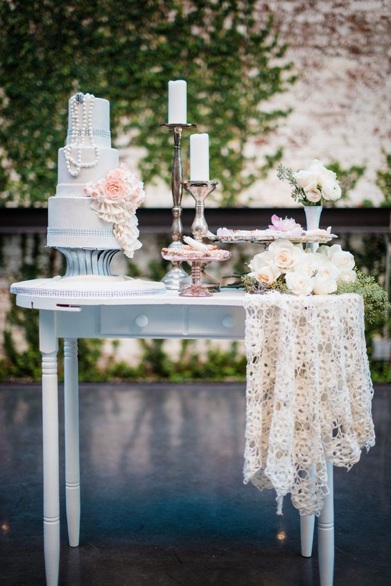 Dreamy vintage wedding cake table at The Foundry, an industrial venue in Long Island City, NY. Photography by Kate Ignatowski.