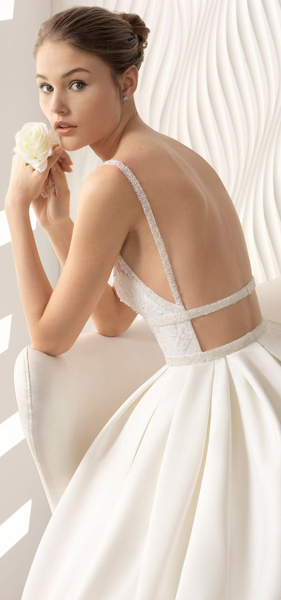 Classic-style beaded lace and ottoman wedding dress with V-neckline and low back from the 2018 Rosa Clará Collection.