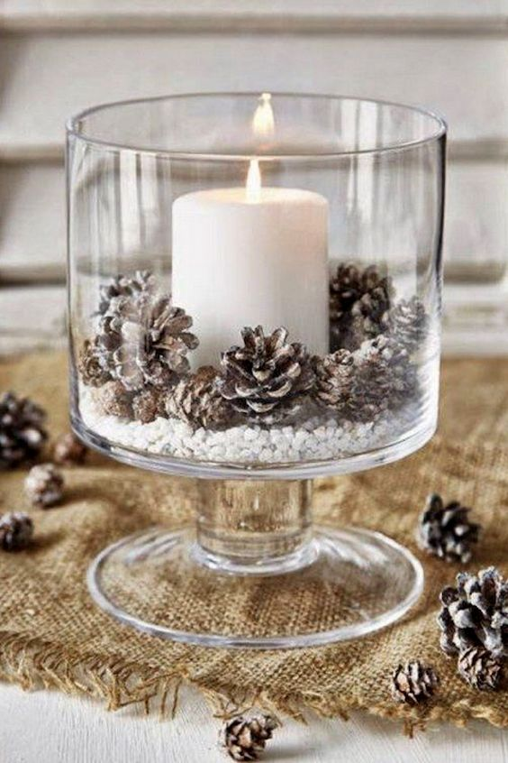 Budget-friendly winter pinecone and candle wedding centerpiece.