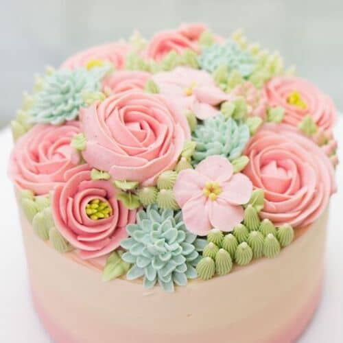 Delicate buttercream flowers on a springtime cake!