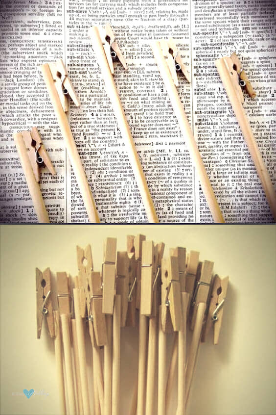 Clothespin table number holders for outdoor weddings and you can even shove them in the sand.