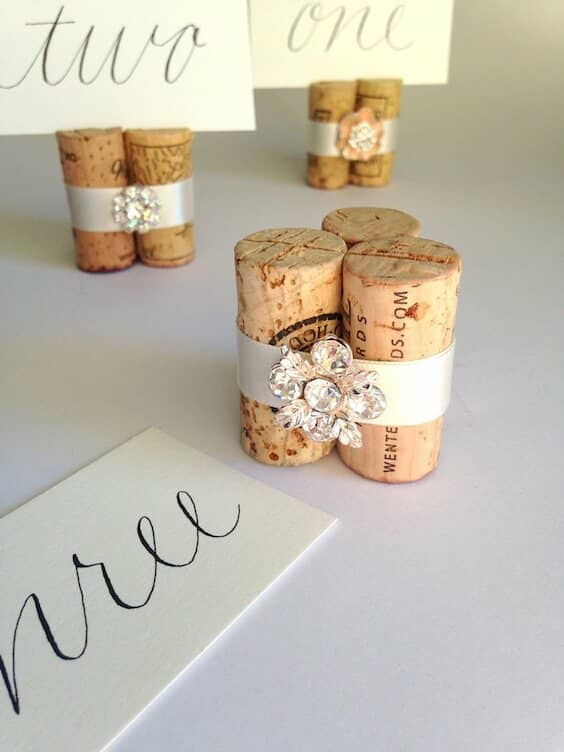 Corks, ribbons and bling for a simple table number holder.