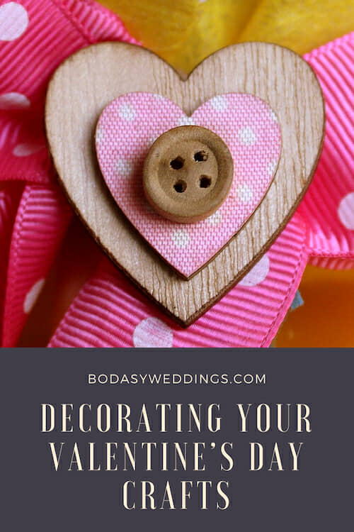 Decorating your Valentine's Day crafts with hearts and buttons.