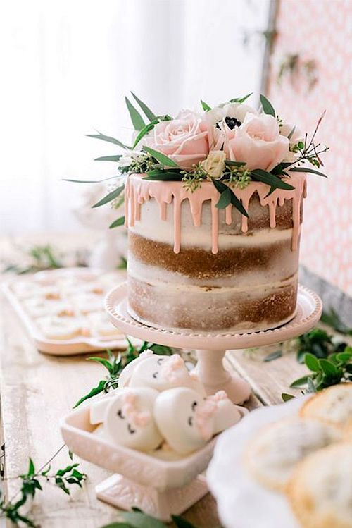 Drip cakes will steal the show. Elegant enchanted forest themed wedding cakes with floral and greenery toppers.