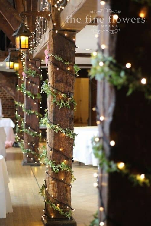 Ivy and fairylights wedding reception at Great Fosters, Surrey, UK.