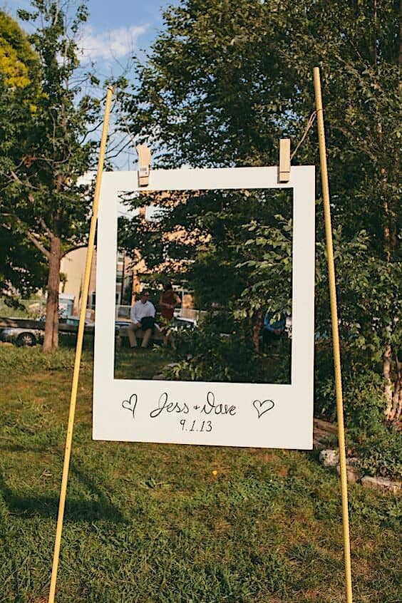 This giant polaroid frame is a great spin on a photo booth for a backyard wedding.