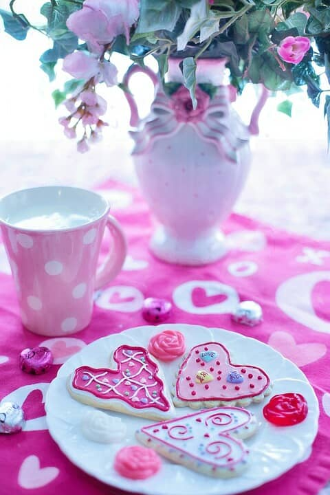 Heart-shaped cookies on a sweet vintage table decor.