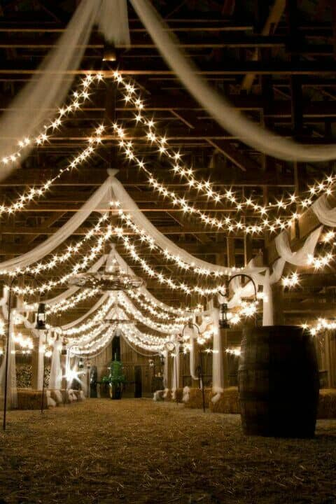 Market lights and draped fabric wedding reception lighting ideas.