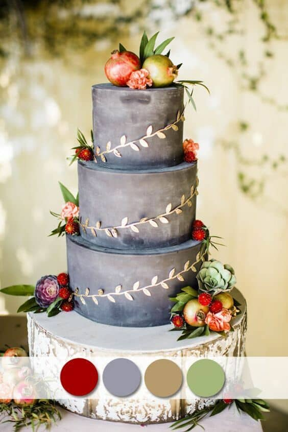 Three tiers of smooth autumn gray with succulents, berries and a delicate gold vine atop a rustic wooden slab.