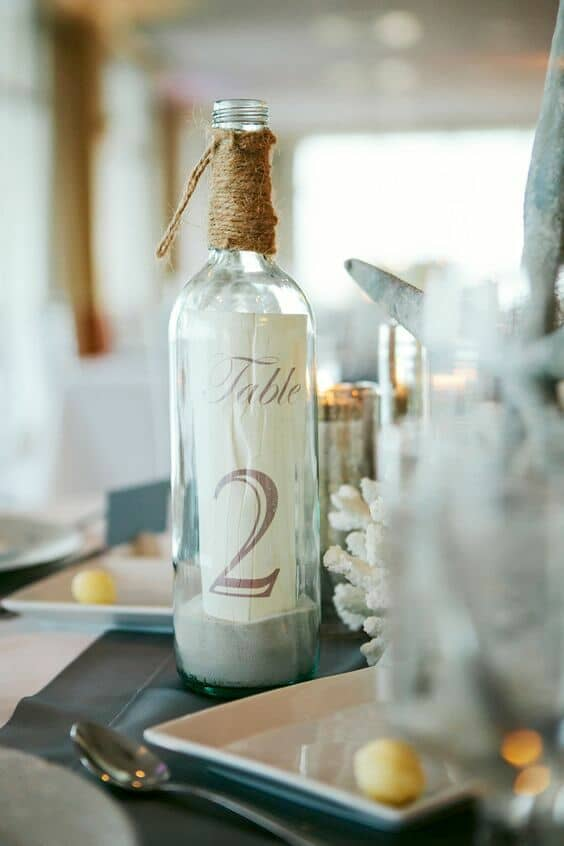 Enjoy your seaside soiree wth these adorable table numbers in a bottle. Monika Gauthier Photography.