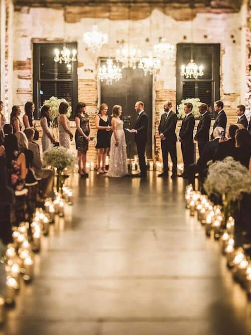 Candlelight and chandeliers for ultra glam industrial romance.