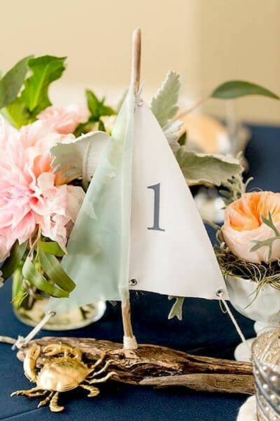 Upgrade your style with a unique sailboat table number.