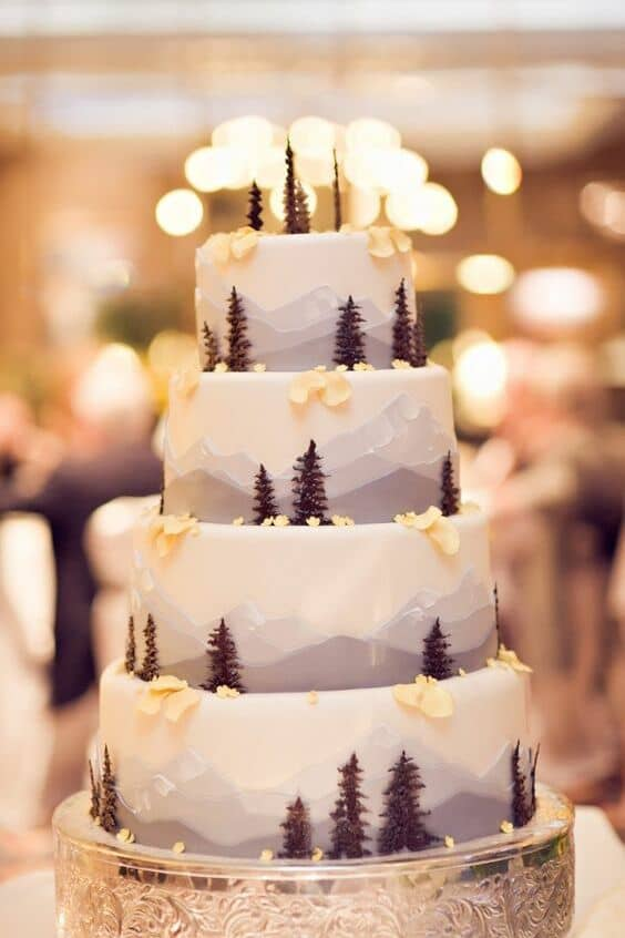 Rocky Mountain themed wedding cake. Real Photography.