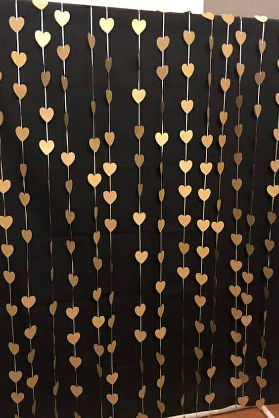 Gold hearts photo booth backdrop and wedding curtain ceremony.