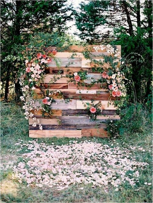 Woodland weddings can portray a flower pallet wall. Lynchburg, Virginia wedding photographed by Adam Barnes Photography.