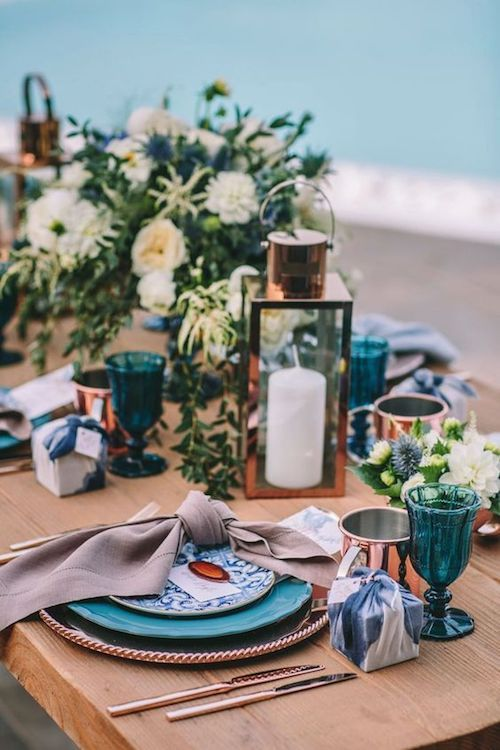 Destination weddings tend to have a small number of guests and a larger number of events. Indigo blue and copper tablescape, Mykonos Island, Greece.