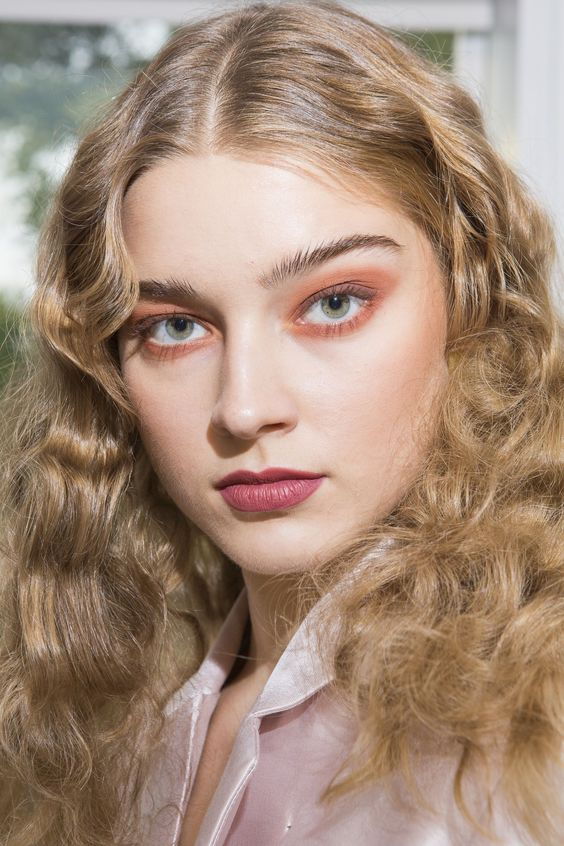 Cynthia Rowley's 2018 romantic look with pouty soft petal-pink lips.