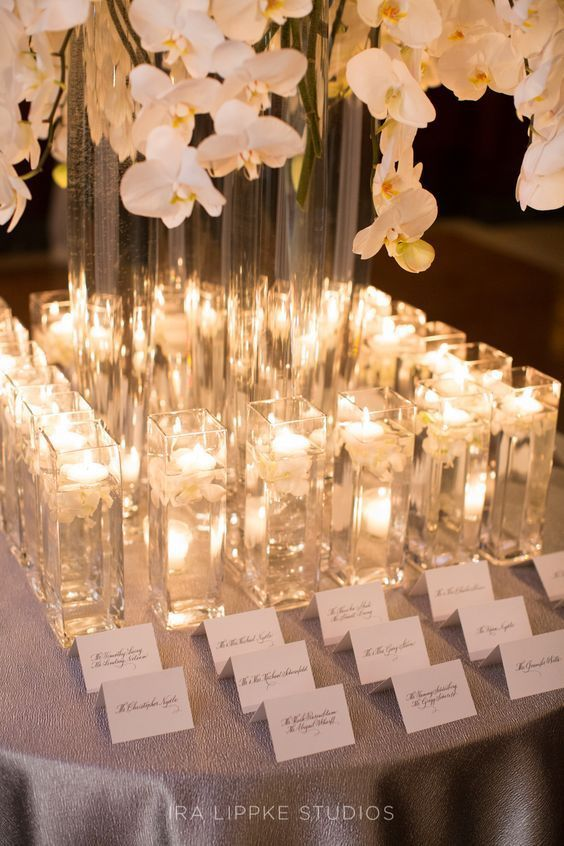 Stylish wedding reception welcome table. Photo: Ira Lippke Studios.