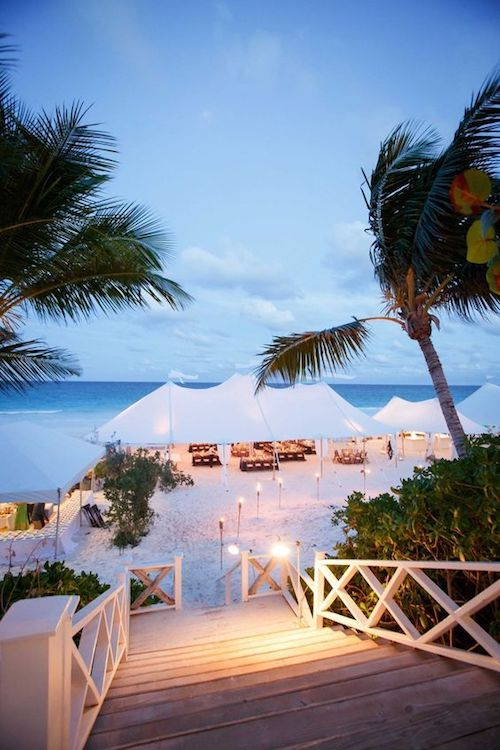 Tented sailcloth reception on the white sands of Harbour Island, Bahamas. Photo: Karlisch Photography.