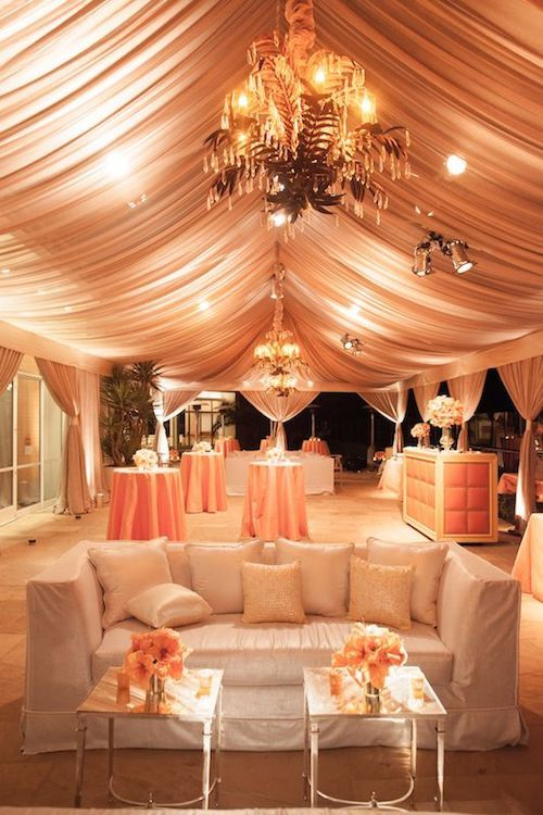 Love how the tent was placed right by the house with a couple of curtains mimicking the opposite side of the wedding tent decor. Perfectly peach lounge by soevents. Special Occasions Event Planning.