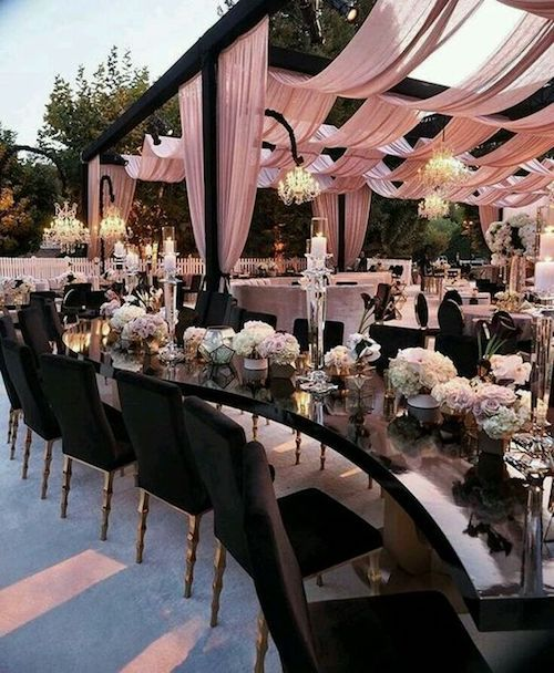 Dreams are made of this. Black and pink wedding tent decor and a magnificent tablescape to match. This is what I call a TD backyard wedding!
