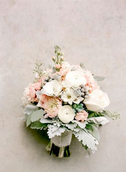 Add some sage leaves for good luck to this short stemmed blush pink bridal bouquet.