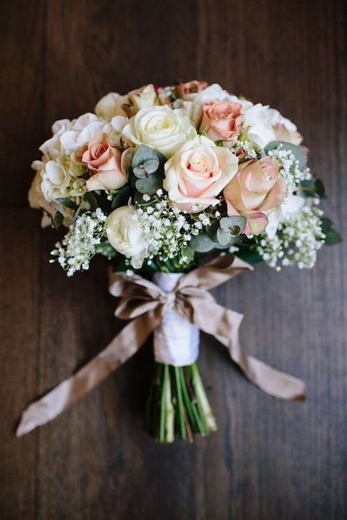 Vintage-inspired rose, gypsophila, white and blush wedding bouquet.