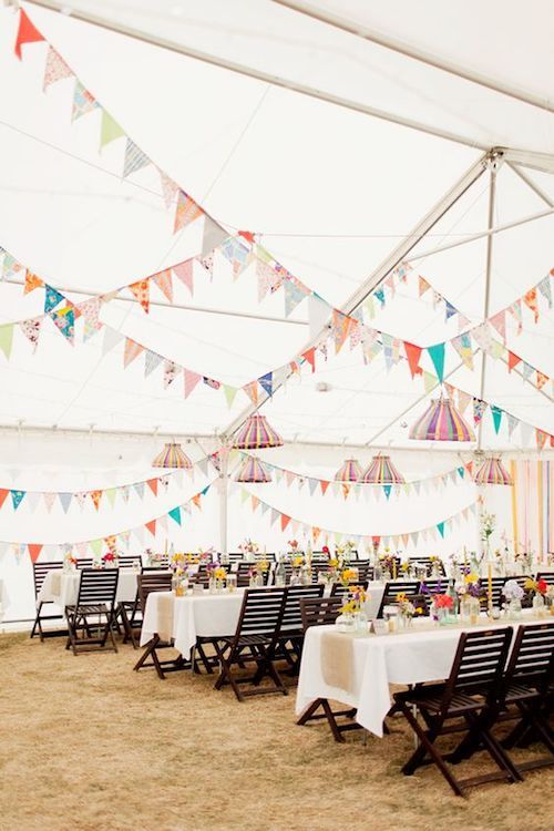 Boho chic Cape Cod beach wedding with colorful flags to match.