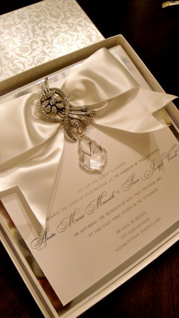 Strikingly beautiful boxed wedding invitations.