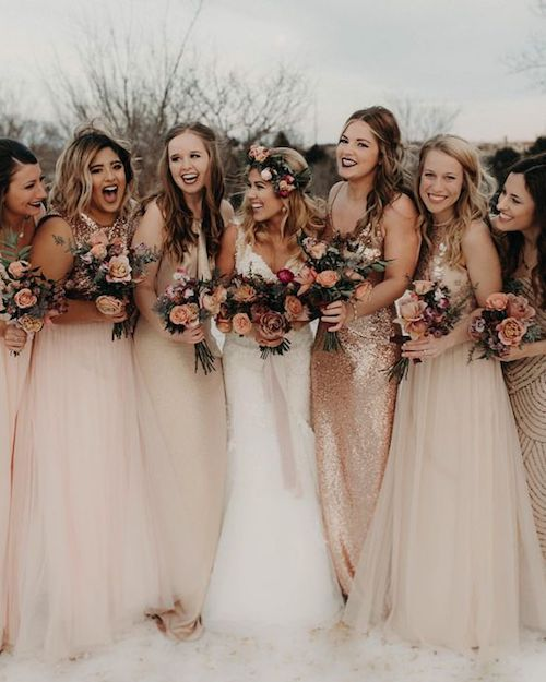 Should your bridesmaids carry the same bouquet as the bride? Of course they can! Just a smaller version of it.