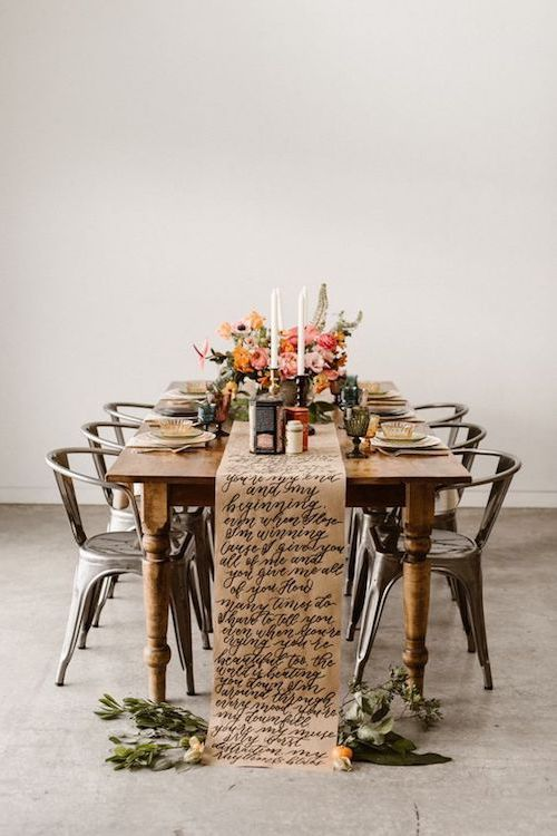 "Told you this idea would steal your heart!! Nothing more romantic than having the lyrics to ""All Of Me"" by John Legend written in calligraphy on your table runner. Image by Carrie J Photography."