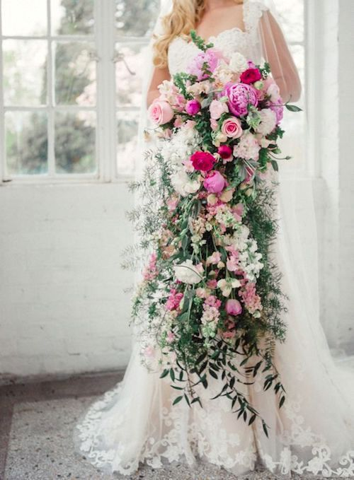 Impressive pink and greenery cascading bouquet for a very tall bride by L.B. Floral. Photography: jo photo online.