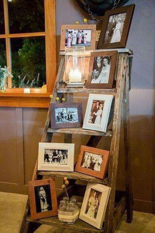 Great vintage wedding decor ideas with ladders and old photos.