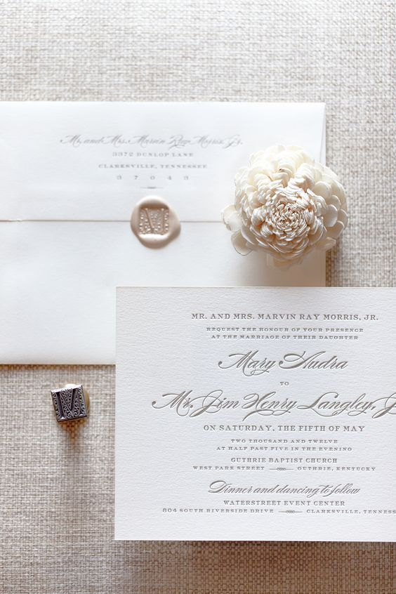 Simple and elegant ivory invite with personalized wax seal monogram.