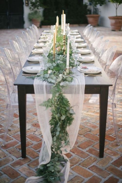 White, green and gold eucalyptus garland table runners that fall off the edge of table. Image: Lauren Carroll Photography.