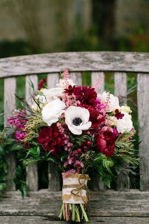 Gorgeous fall wedding bouquet with anemones and ranunculus.