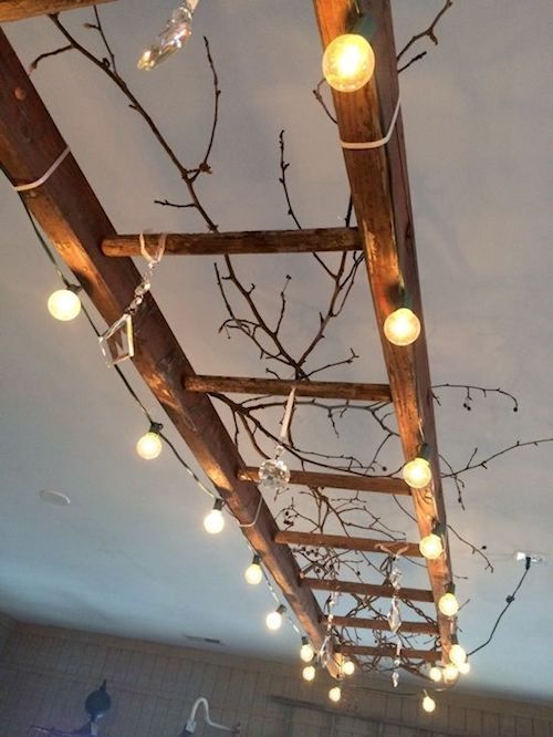 Twigs and Edison lightbulbs for a fall wedding. I'm in love!