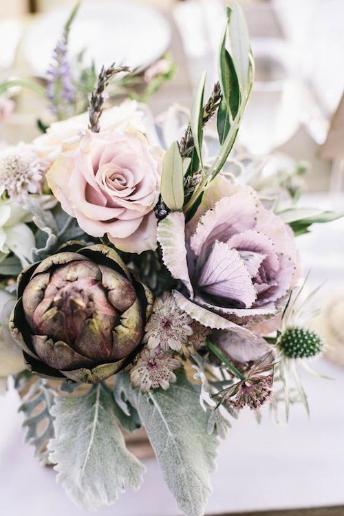 The artichoke will make this floral design a bit on the heavy side but its purple tones complement the roses and thistles to perfection.