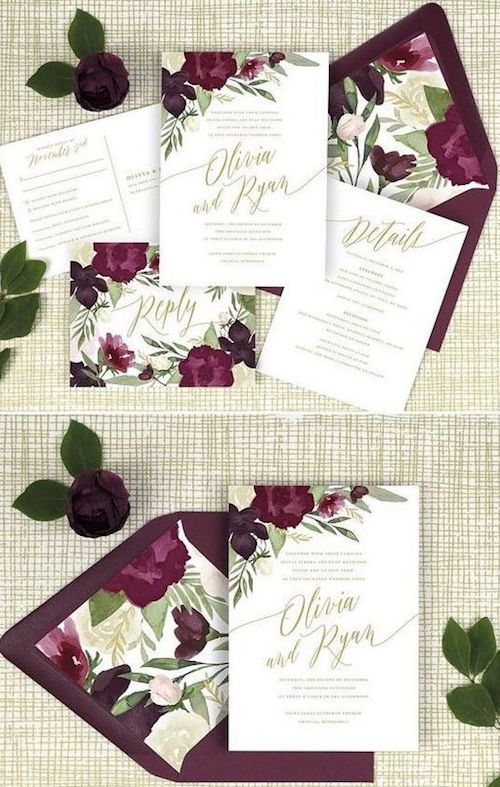 Burgundy and gold floral wedding invitations with lined envelopes.