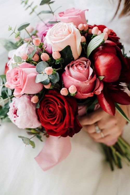 Red and pink flower bouquet with roses and peonies.